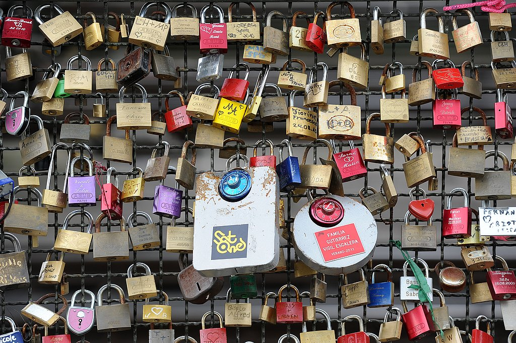 Liebesschloesser, or love padlocks, are affixed to a fence on Hohenzollernbruecke bridge in Cologne, Germany.