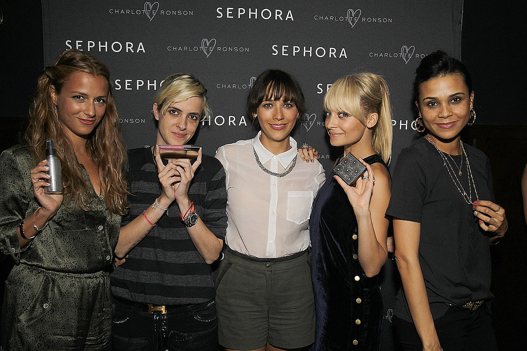 Charlotte, Samantha, Nicole, and Rashida and Kidada Jones held up products from the Charlotte Ronson Beauty line.