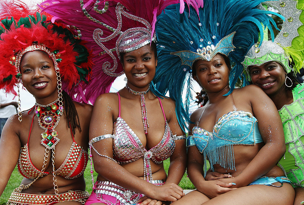 The ladies of the Genesis Mas Band are ready to perform at the Notting Hill Carnival.