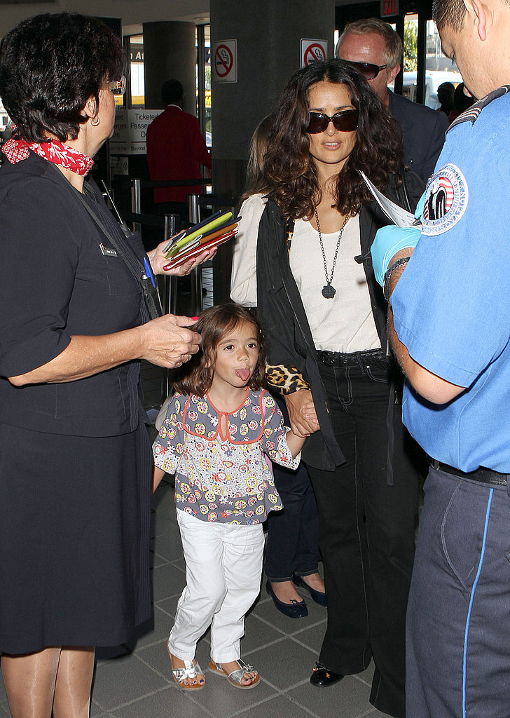 Valentina and Salma handed over their passports to the TSA official.