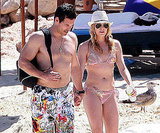 She and Eddie held hands in the sand in Mexico in March 2010.