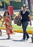 Kris Humphries carried a Louis Vuitton bag leaving Naples.