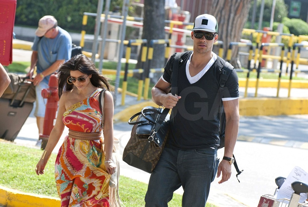 Kim Kardashian and Kris Humphries traveled alone to Italy.