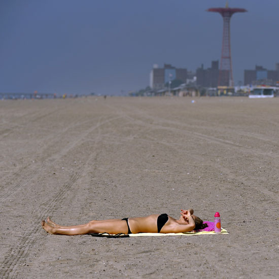 A woman takes advantage of the empty beach at Coney Island as New York preps for Hurricane Irene.