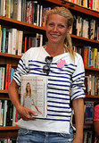 Gwyneth Paltrow posed with a copy of her cookbook.