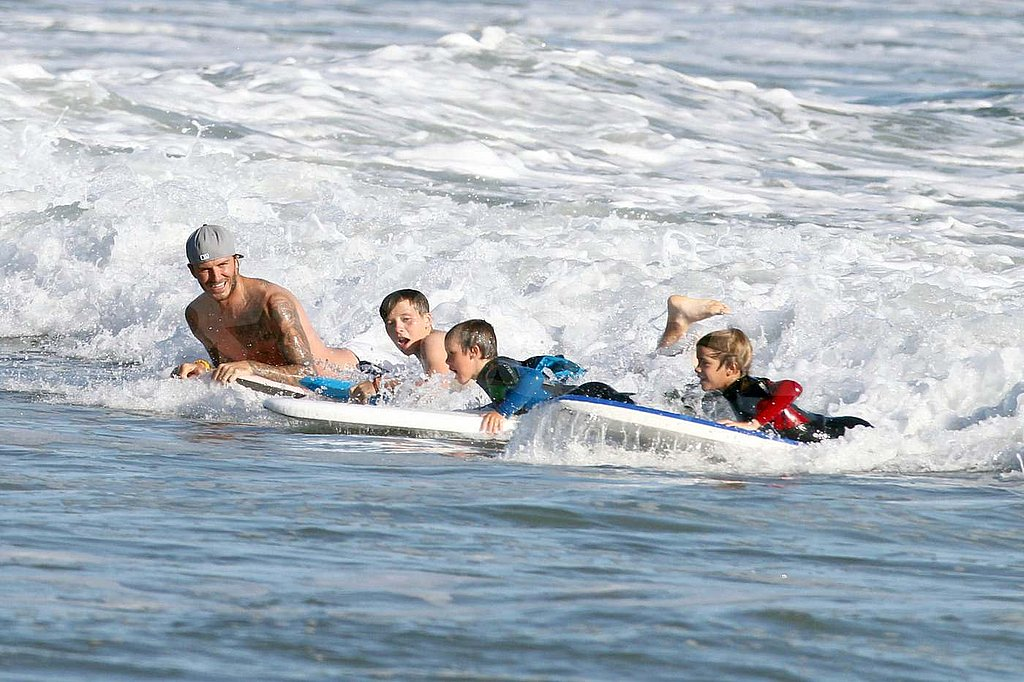 Shirtless David Beckham with Romeo, Cruz, and Brooklyn in Malibu.