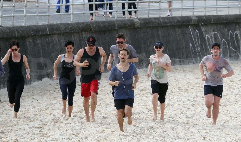 Tobey Maguire and Carey Mulligan run on the beach in Sydney.