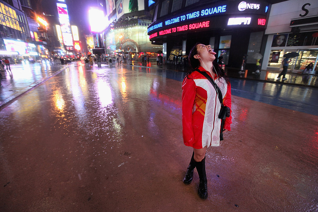 A woman tastes the rain before the storm hits Times Square.