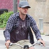 Justin Timberlake riding a bike.