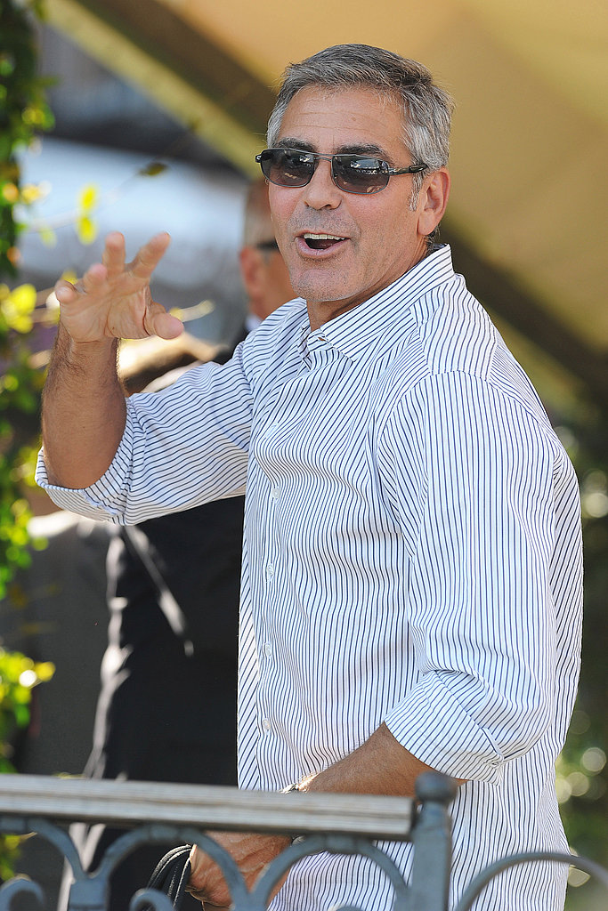 George Clooney waves to fans in Venice.