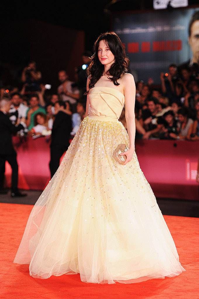 W.E. actress Andrea Riseborough wore a full, yellow gown to the movie's premiere.