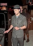 Justin Timberlake in a plaid shirt and hat.