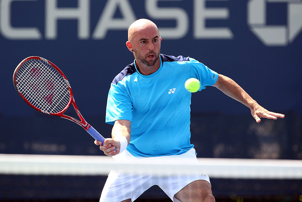 Jamie Delgado of Great Britain returns a shot against Marcelo Melo and Bruno Soares of Brazil on Friday.