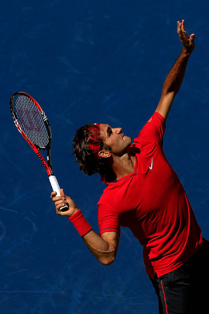 Switzerland's Roger Federer reaches high to serve against Dudi Sela of Israel during day four.