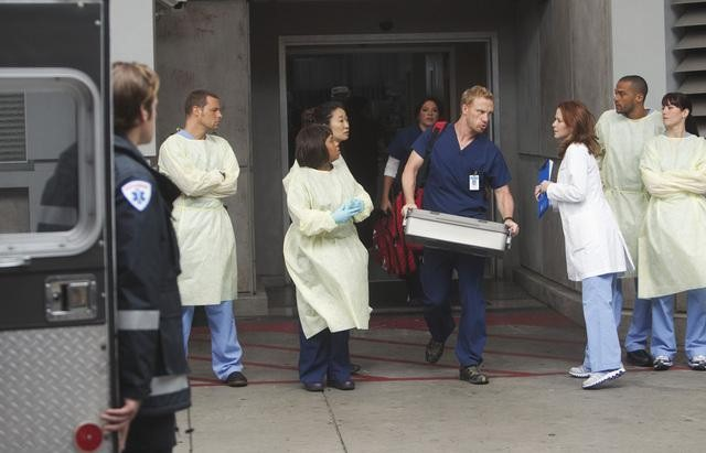 Sarah Drew as Dr. April Kepner, Sandra Oh as Dr. Cristina Yang, Justin Chambers as Dr. Alex Karev, and Chandra Wilson as Dr. Miranda Bailey, and Kevin McKidd as Dr. Owen Hunt on Grey's Anatomy.  Photo copyright 2011 ABC, Inc.