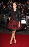 Emma Watson in a plaid dress on the red carpet in London.