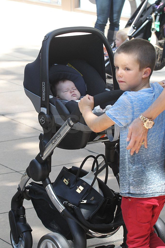 Cruz Beckham pushed Harper's stroller.
