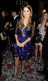 Princess Beatrice in a short purple dress.
