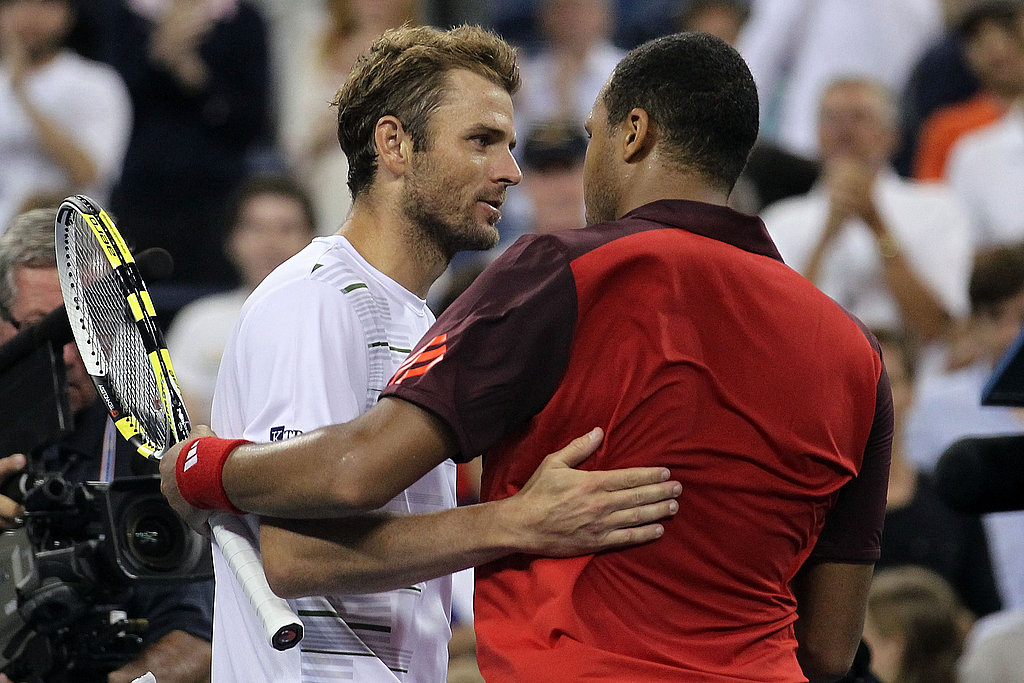 Jo-Wilfried Tsonga of France shakes hands with America's Mardy Fish after their match.