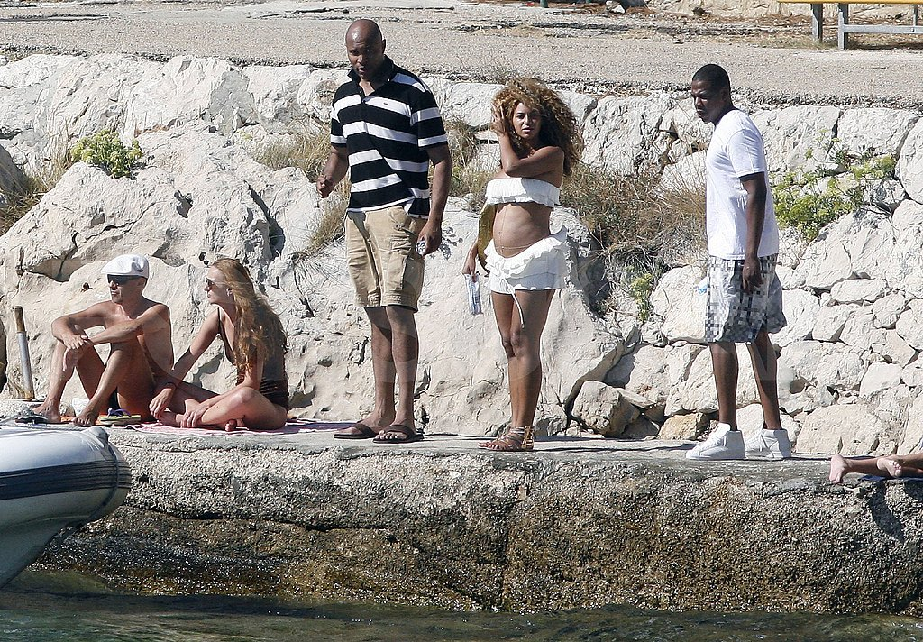 Pregnant Beyoncé Knowles in a white bikini with husband Jay-Z.
