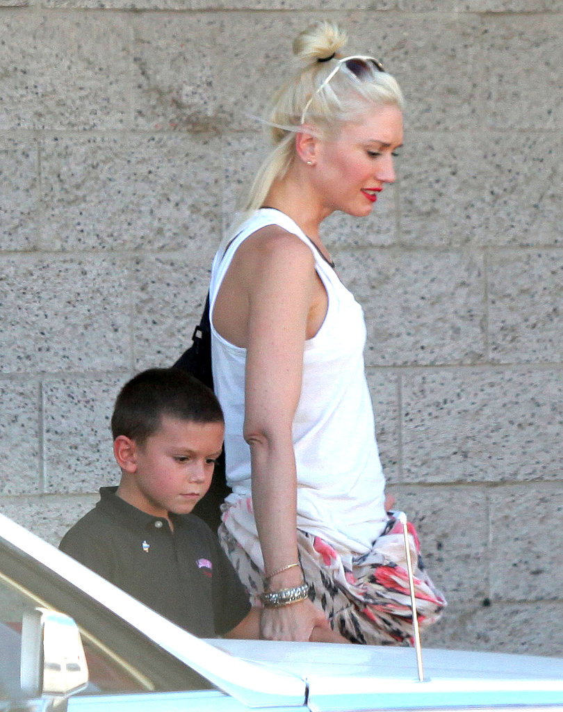 Kingston and Gwen chatted on their way to the car.