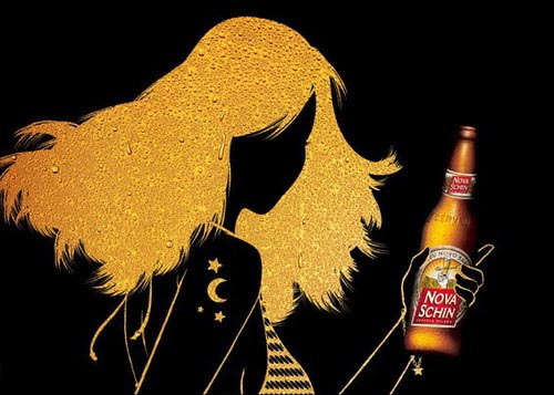 This artsy add shows a glowing woman drinking a beer, although they haven't managed to put her in something other than the predictable bikini.
