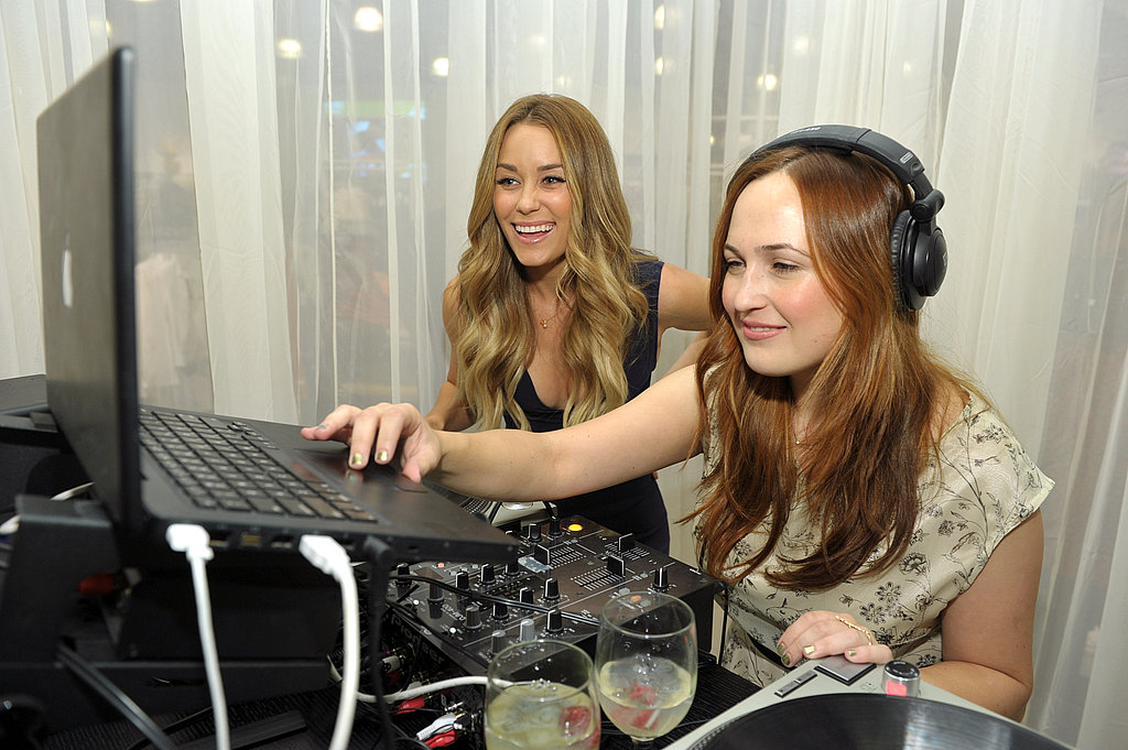 Lauren Conrad checked out the playlist at Fashion's Night Out.