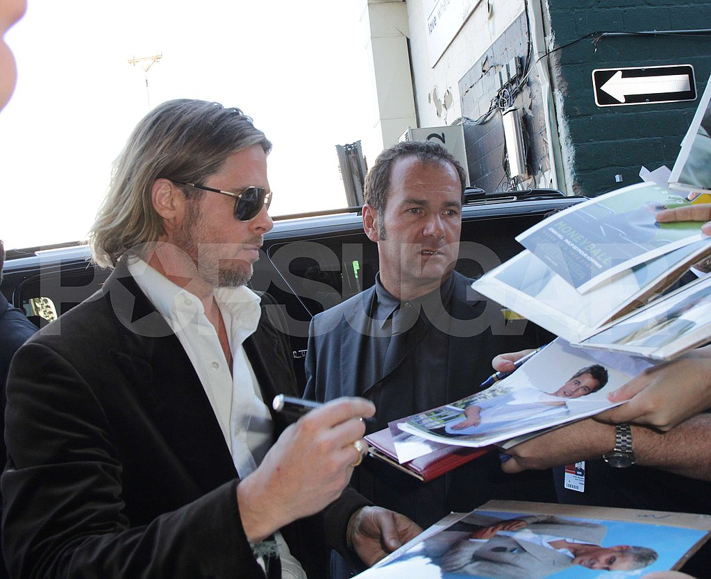 Brad Pitt signed autographs for fans at the Toronto International Film Festival where he promoted Moneyball.