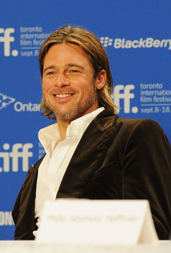 Brad Pitt flashed his sexy smile.