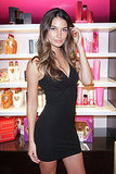 Lily Aldridge in a black dress.