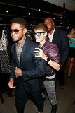 Justin Bieber held Usher's shoulders at Dolce & Gabbana.