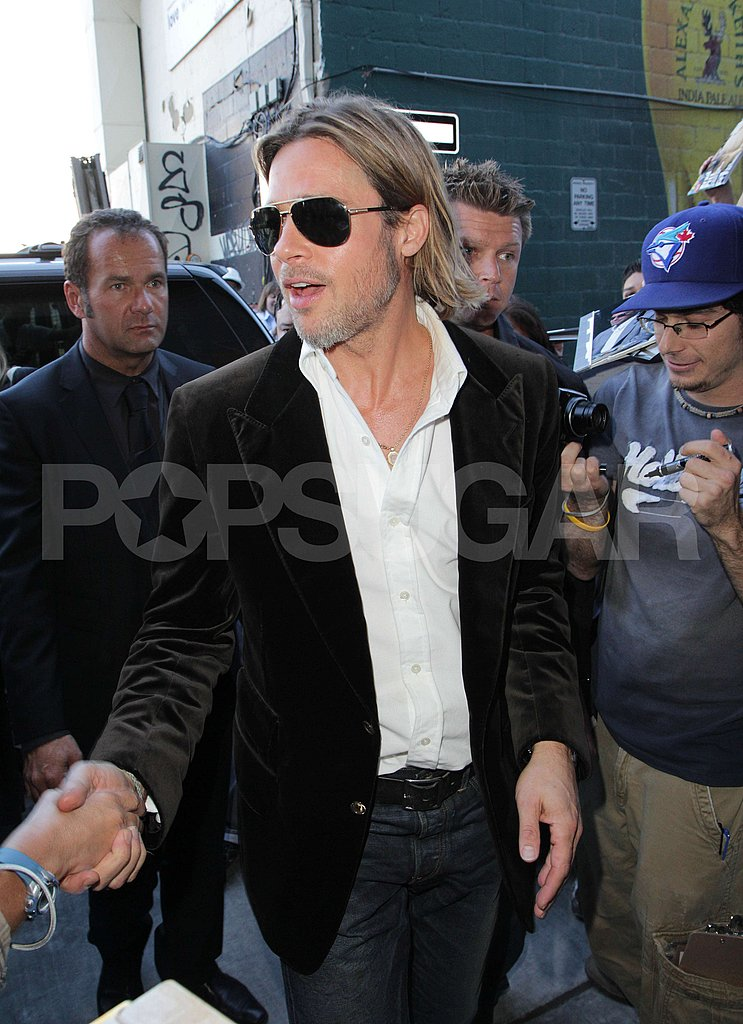 Brad Pitt looked sexy in a black suit at the Toronto Film Festival.