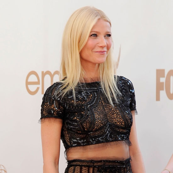 Gwyneth Paltrow shows abs in Pucci.