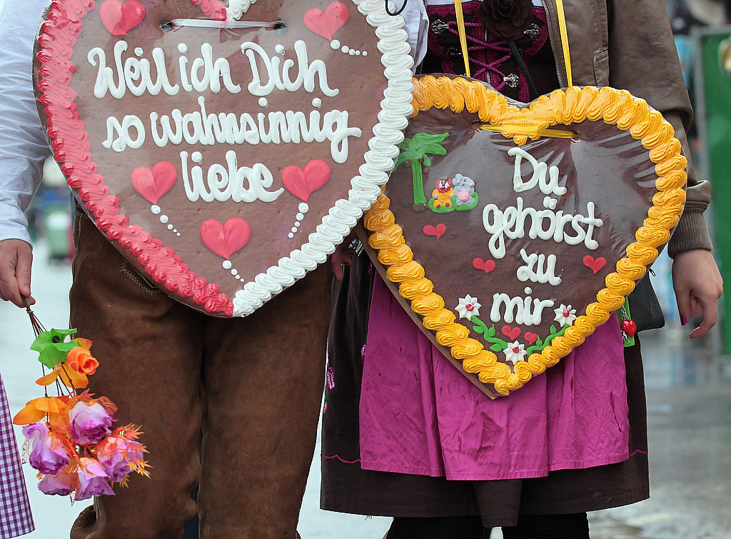 A couple wears their hearts on their chests at Oktoberfest.