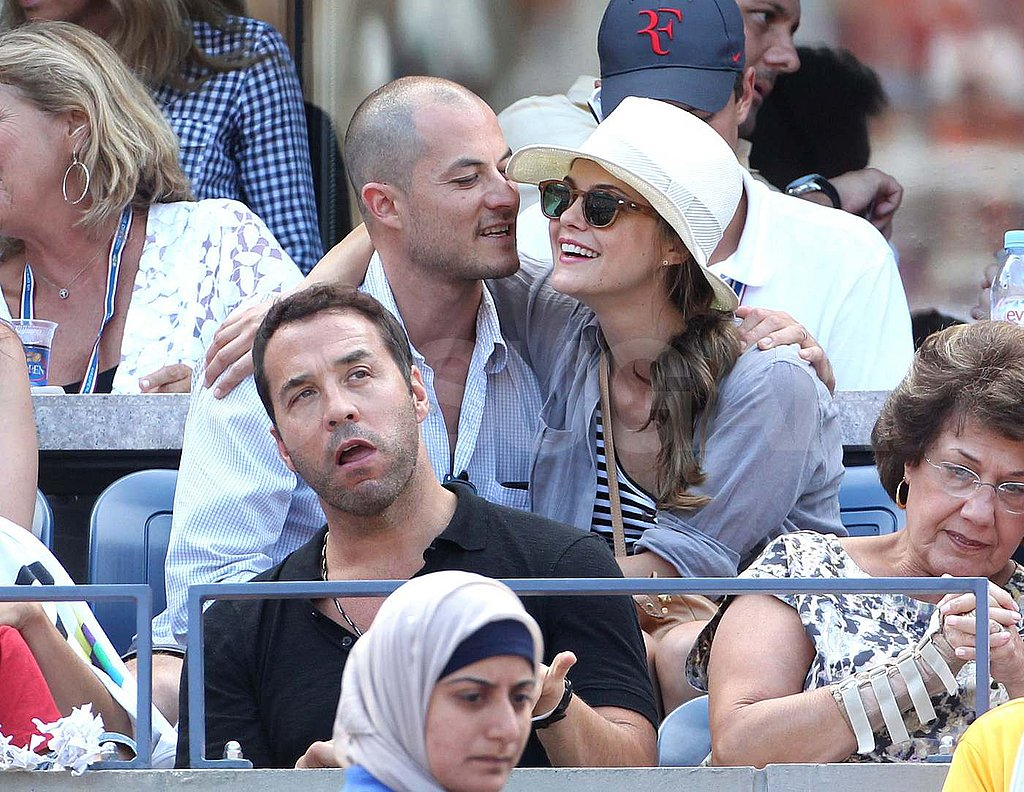 Keri Russell and Shane Deary behind Jeremy Piven at the US Open.