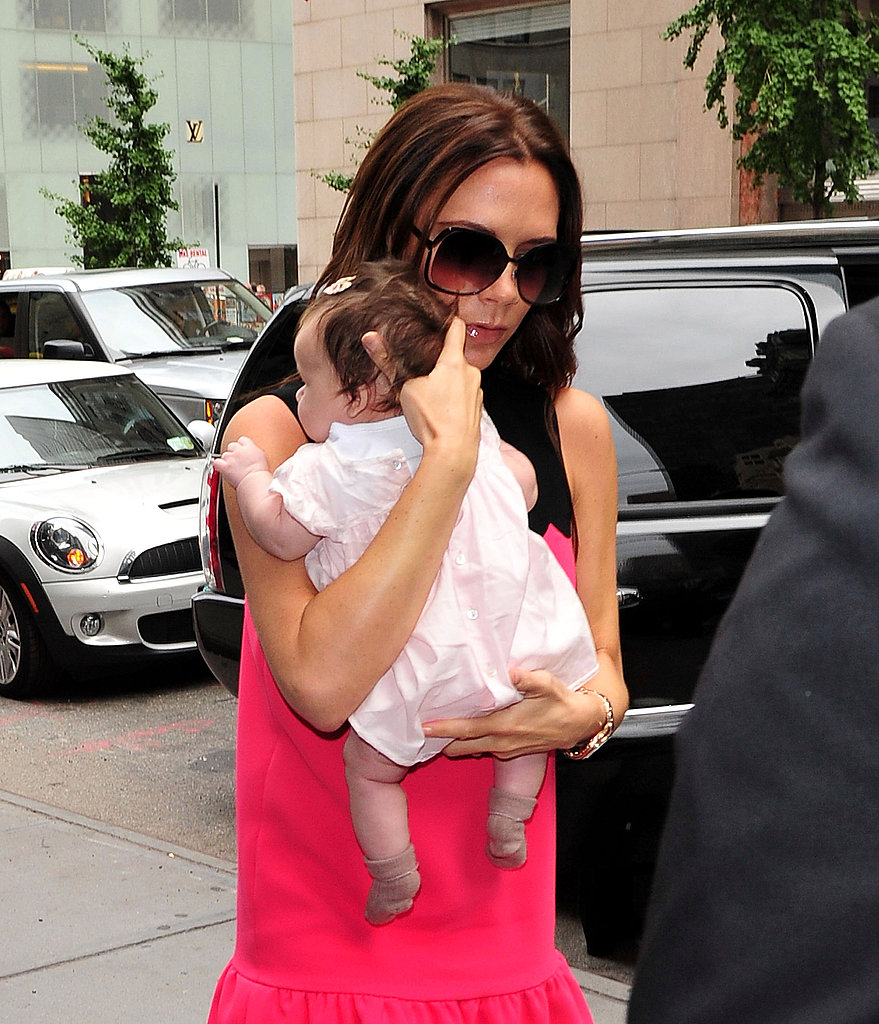 Victoria Beckham carried Harper after her show.