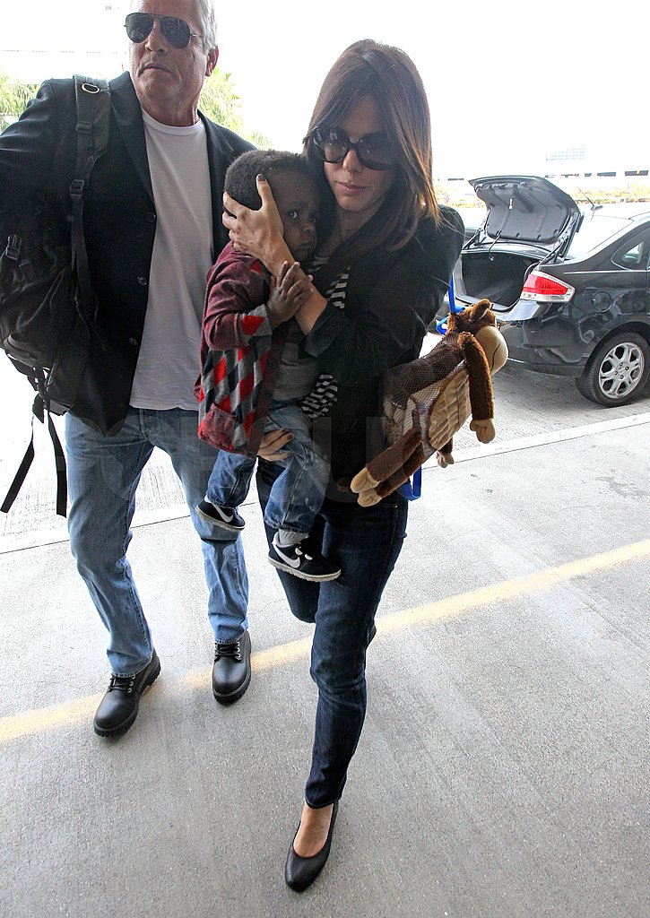 Sandra Bullock and Louis Bullock went to the airport.