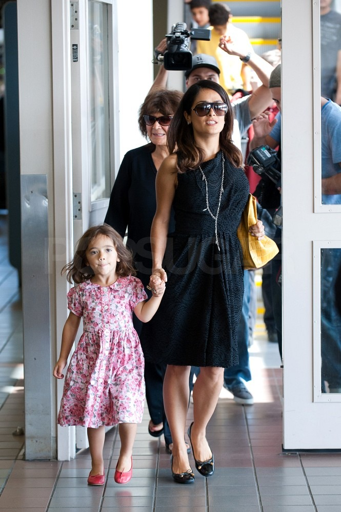 Salma and Valentina held hands leaving LAX.