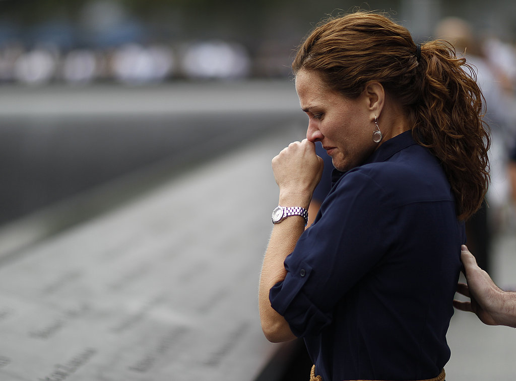 A woman cries as she looks at the memorial wall on the 10th anniversary of the World Trade Center attacks.