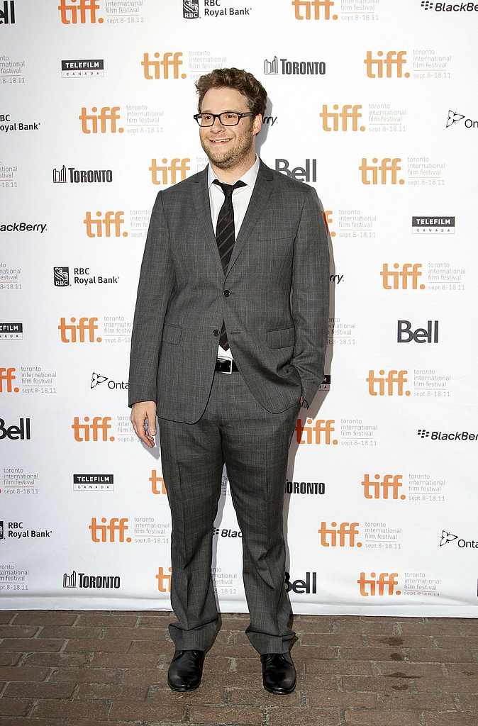 Seth Rogen in a gray suit.