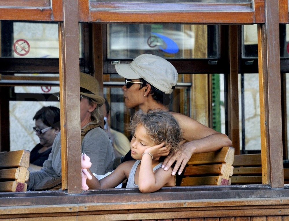 Nahla Aubry looked out the window of a street car while riding through Majorca with Halle Berry.