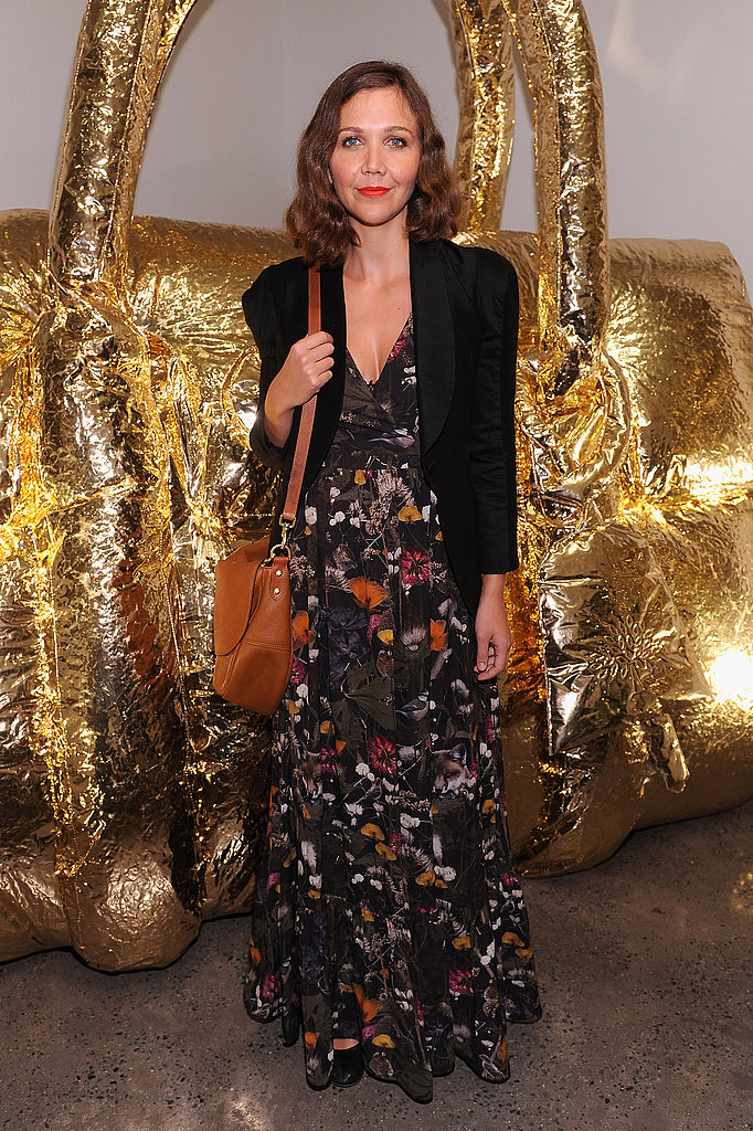 Maggie Gyllenhaal arrives in a floral maxi and blazer.