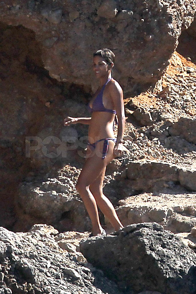 Halle Berry in a purple bikini.