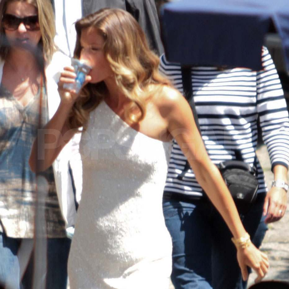 Gisele Bundchen in a white dress on set in Brazil.
