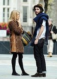 Sienna Miller smoking and talking to boyfriend Tom Sturridge.