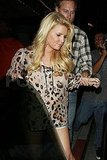 Jessica Simpson in a leopard print top.