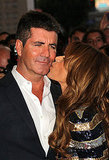 Paula planted a big kiss on Simon's cheek.
