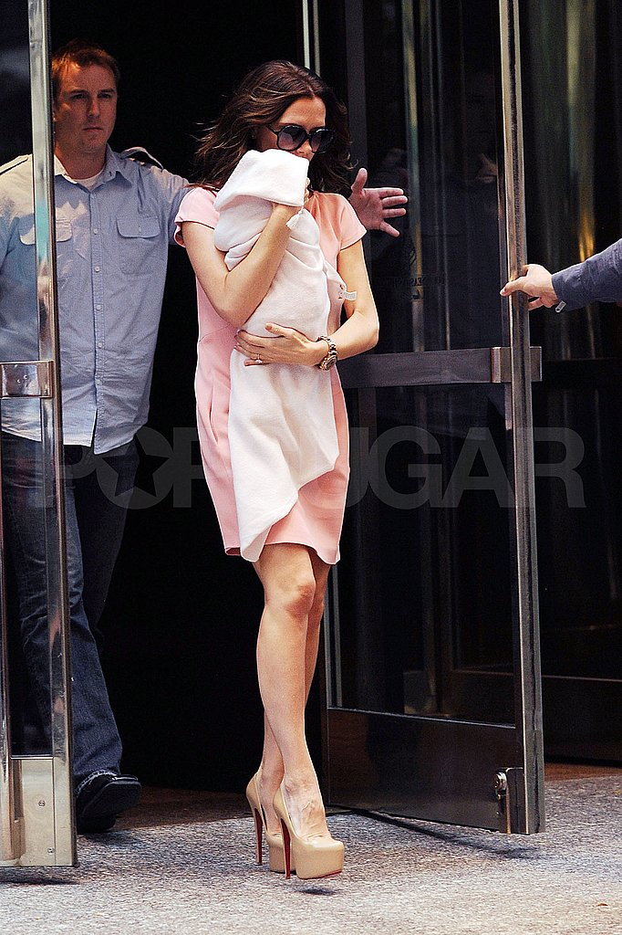 Victoria Beckham carries daughter, Harper Seven Beckham, in NYC.
