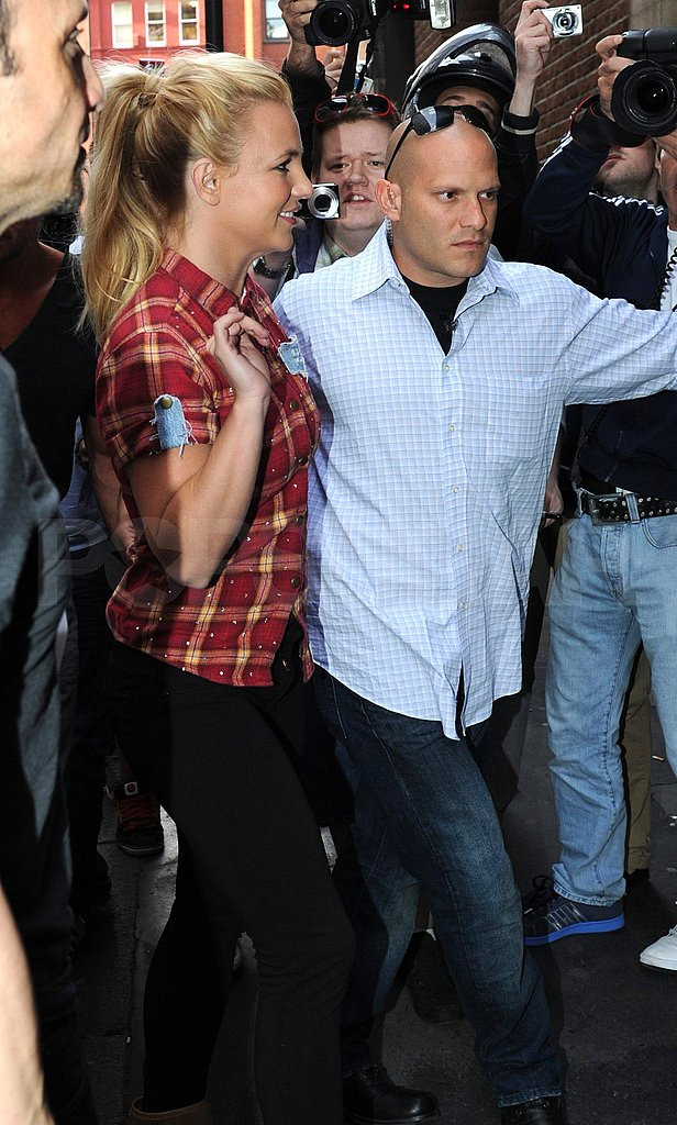 Britney Spears with her security guard.