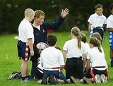 Prince Harry helps coach children at Greenfield Primary School in 2004.